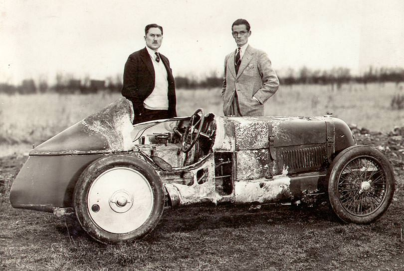 George Eyston (left) with the fire-damaged MG Midget he used to challenge the flying mile record at Brooklands, 1931.