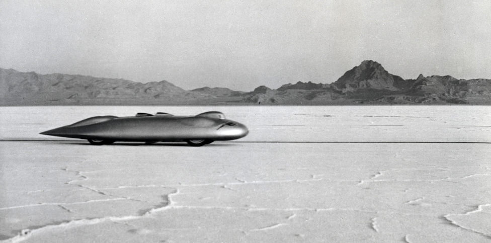 John Cobb and the Railton Mobil Special land speed record car on a record run at the Bonneville salt flats.