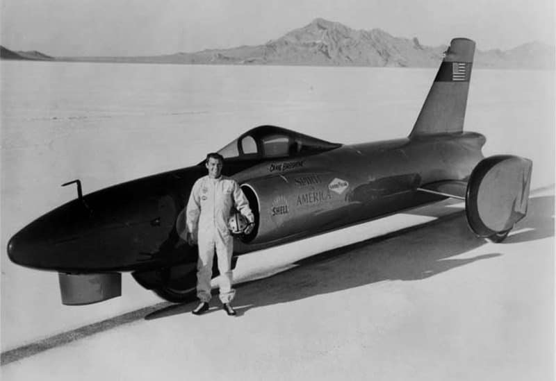 Craig Breedlove poses with his first world land speed record car, Spirit of America.