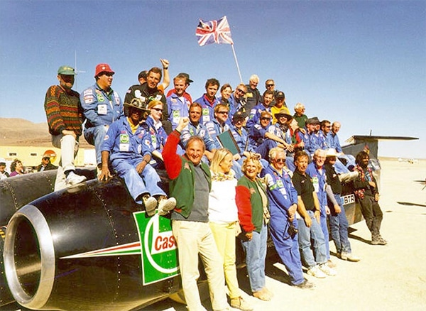Andy Green, Richard Noble and the Thrust SSC team pose with the car at the Black Rock Desert in Nevada.